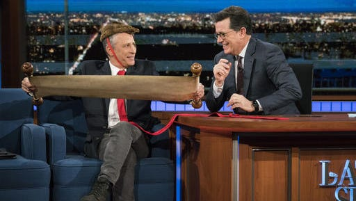 "This Jan. 31, 2017 image released by CBS shows Jon Stewart, left, with host Stephen Colbert during a visit to ""The Late Show with Stephen Colbert,""  in New York. The former ""Daily Show"" host appeared on Tuesday night's ""Late Show"" dressed as President Donald Trump, wearing a suit with an overly-long red power tie. He also mocked Trump's hair by wearing a stuffed animal on his head."