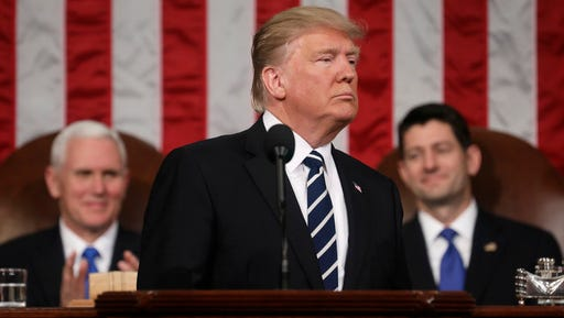 President Donald Trump addresses a joint session of Congress on Capitol Hill in Washington, Tuesday, Feb. 28, 2017. Vice President Mike Pence and House Speaker Paul Ryan of Wis. listen. (Jim Lo Scalzo/Pool Image via AP)