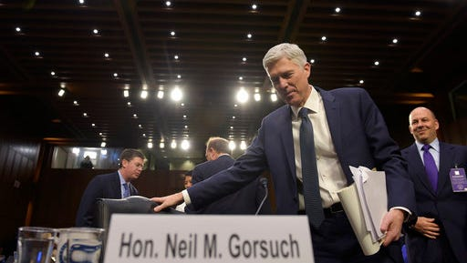 Supreme Court Justice nominee Neil Gorsuch return from a break to continue his testimony on Capitol Hill in Washington, Wednesday, March 22, 2017, during his confirmation hearing before the Senate Judiciary Committee.