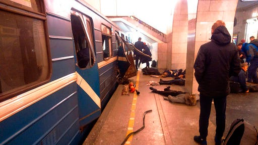 Blast victims lie near a subway train hit by a explosion at the Tekhnologichesky Institut subway station in St.Petersburg, Russia, Monday, April 3, 2017. The subway in the Russian city of St. Petersburg is reporting that several people have been injured in an explosion on a subway train.