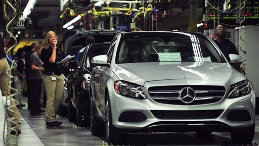 The Tuscaloosa County operation of Mercedes-Benz unveiled the new Vance, Alabama-built Mercedes C-Class, Wednesday. It is the first sedan built at the Alabama plant.  The sedan is also being produced at Mercedes factories in Germany, South Africa and China. Employees work on the production line of the sedan.  (AP Photo/Tamika Moore, AL.com)