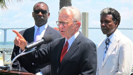 Mayor Joseph P. Riley Jr., center, announces that a $75 million International African American Museum will be built at the site of a wharf in Charleston, during a Tuesday news conference in Charleston, S.C. The site is where tens of thousands of slaves first set foot in the United States. Behind the mayor are Wilbur Johnson, left, the chairman of the board of the museum, and artist Jonathan Green, whose colorful paintings of the black culture of the sea islands of the Southeast coast are in collections worldwide. Riley said construction of the museum could begin in early 2016 with completion two years later.