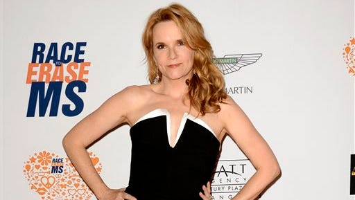 """Lea Thompson arrives at the 21st Annual Race to Erase MS Gala in Los Angeles. Thompson is one of 13 contestants on the new season of """"Dancing With the Stars,"""" premiering Sept. 15, on ABC."""