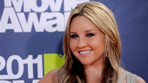 Amanda Bynes arrives at the MTV Movie Awards in Los Angeles. Bynes was arrested early on Sunday and booked on suspicion of driving while under the influence of a drug. She was released after posting $15,000 bail.