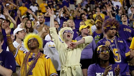 LSU fans cheer in the second half of an NCAA college football game against Louisiana Monroe in Baton Rouge, La., Saturday, Sept. 13, 2014. LSU won 31-0.