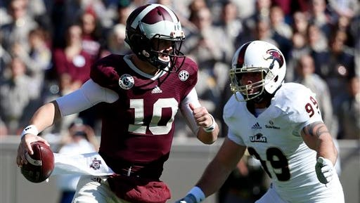 Texas A&M quarterback Kyle Allen (10) scrambles out of the pocket under pressure from Louisiana Monroe defensive lineman Joey Gautney (99) during the first half of an NCAA college football game, Saturday, Nov. 1, 2014, in College Station, Texas. (AP Photo/Tony Gutierrez)