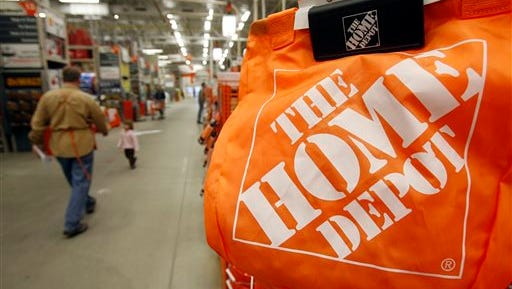 In this Feb. 22, 2010, file photo, shoppers walk through the aisles at the Home Depot store in Williston, Vt. Home Depot on Thursday said it has eliminated malware from its U.S. and Canadian networks that affected 56 million unique payment cards between April and September.