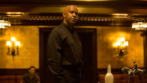 """In this image released by Columbia Pictures, Denzel Washington appears in a scene from """"The Equalizer."""""""