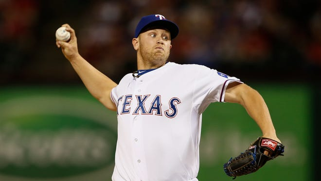 Texas Rangers relief pitcher Seth Rosin (19) throws to the Philadelphia Phillies during the ninth inning of a baseball game, Wednesday, April 2, 2014, in Arlington, Texas. The Rangers won 4-3. (AP Photo/Jim Cowsert)