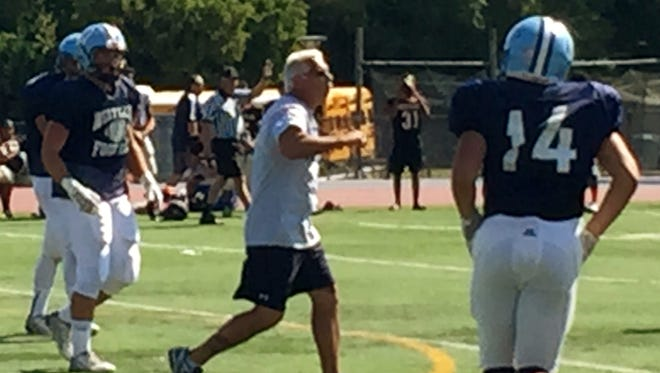 First-year Westlake coach shouts encouragement in between plays Saturday during a scrimmage at White Plains High School.
