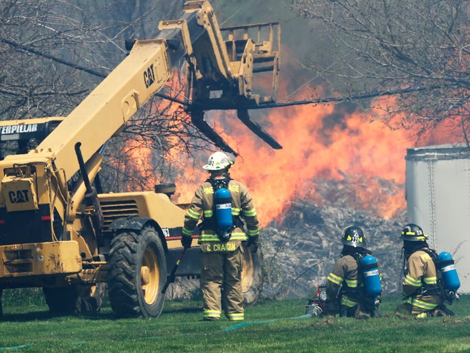 Firefighters battle a large pallet fire Tuesday, May 6, 2014, at Reynolds Wood Products, 405 N. High Street in West Lebanon. According to John Goodrick, West Lebanon Fire Chief, the fire began as a controlled burn that quickly got of hand due to high winds. Numerous fire departments from miles around responded.