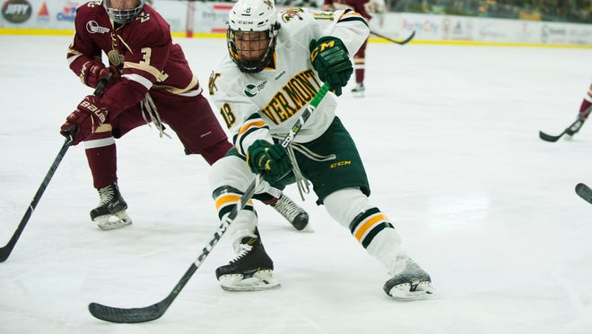 Vermont defenseman Matt O'Donnell (18) skates past Eagles defenseman Luke McInnis (3) with the puck during the men's hockey game between the Boston College Eagles and the Vermont Catamounts at Gutterson Field House on Friday night November 10, 2017 in Burlington.