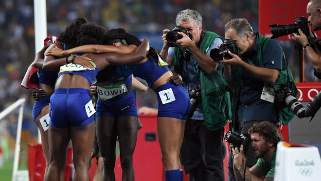 Tianna Bartoletta , Allyson Felix , English Gardner and Tori Bowie celebrate after winning the women's 4x100m relay final in the Rio 2016 Summer Olympic Games at Estadio Olimpico Joao Havelange on Aug. 19.