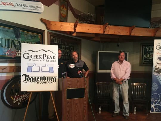 Greek Peak co-owners Marc Stemerman, left, and John Meier, center, join Toggenburg owner Jim Hickey at the Foggy Goggle restaurant at Toggenburg to announce that Greek Peak is acquiring the smaller resort in Fabius, Onondaga County.