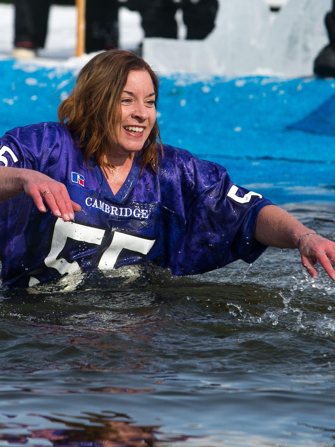 "Kim Zuelsdorf, mother of Dustin ""Dozer"" Zuelsdorf, jumps into Lake Ripley during the Dip For Dozer."