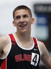 Gilbert's Thomas Pollard smiles at the crowd Saturday, May 23, 2015 after winning the boys 3-A 1600 meter run at the state track meet in Des Moines.