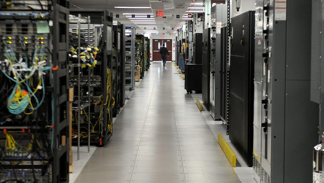 Computer servers line the central corridor of the Systems Test Engineering floor in IBM's Poughkeepsie, N.Y., plant.