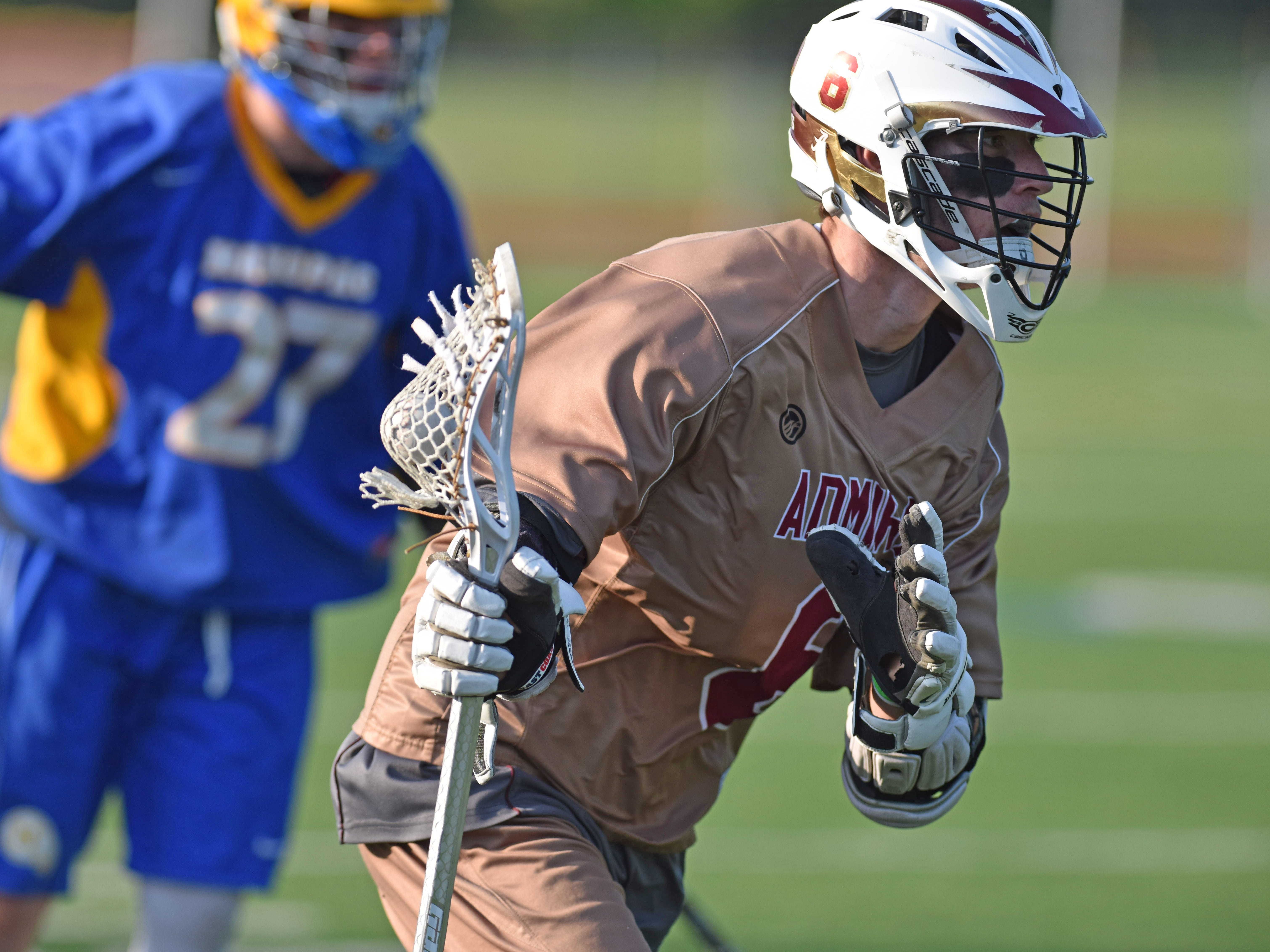 Arlington's Kevin Litchauer carries the ball as Mahopac's Johnnie Ward covers him during Tuesday's game at Arlington on May 19, 2015.