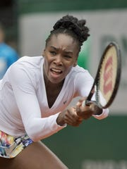 Venus Williams (USA) in action during her match against Anna Schmiedlova May 28 at the 2014 French Open at Roland Garros.