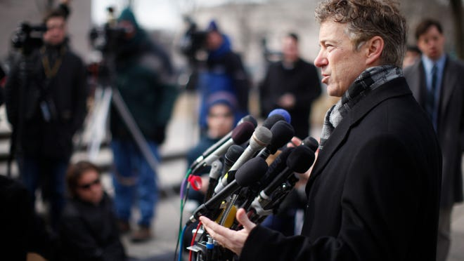 Sen. Rand Paul, R-Ky., speaks to reporters in front of federal court in Washington, Wednesday, Feb. 12, 2014. Claiming the Obama administration is violating Americansí constitutional rights, Sen. Rand Paul and a conservative political group are filing a lawsuit over the National Security Agencyís surveillance program. (AP Photo/Charles Dharapak) ORG XMIT: OTKCD