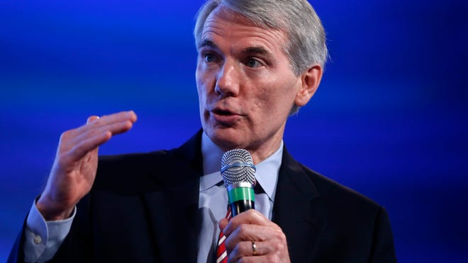 Senate Budget Committee member Sen. Rob Portman, R-Ohio, speaks at the 2014 Fiscal Summit organized by the Peter G. Peterson Foundation in Washington, Wednesday, May 14, 2014. Lawmakers and policy experts discussed America's long term debt and economic future. (AP Photo) ORG XMIT: DCCD105