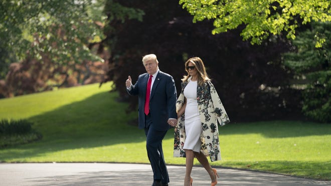 Without taking questions from reporters about the Mueller report, President Donald Trump and first lady Melania Trump walk to board Marine One for the short trip to Joint Base Andrews, then on to his estate in Palm Beach, Fla., at the White House in Washington, Thursday, April 18, 2019.