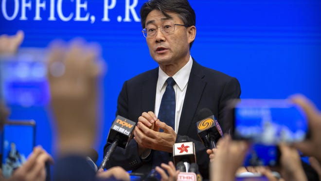 Gao Fu, the head of the Chinese Center for Disease Control and Prevention (China CDC), speaks to journalists after a press conference at the State Council Information Office in Beijing on Jan. 26, 2020. Gao has revealed Tuesday, July 28, 2020 he has been injected with an experimental coronavirus vaccine in what he said is an attempt to persuade the public to follow suit when one is approved.