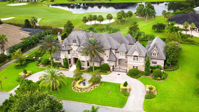 This grand French chateau-style mega mansion  is located on over an acre in Plantation Bay -- an upscale private gated community with optional country club membership.