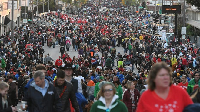 Crowds line the parade route before the start of the 131st Rose Parade in Pasadena on Jan. 1. Organizers have canceled the 2021 Rose Parade because of the impact of the coronavirus pandemic on long-range planning for the New Year's tradition.