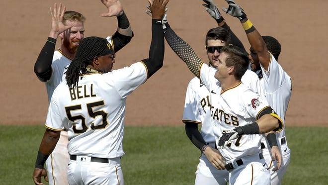 Pittsburgh Pirates' Kevin Newman (27) celebrates with Josh Bell (55) and other teammates after he drove in two runs with a game winning single in the ninth inning of a baseball game against the Minnesota Twins, Thursday, Aug. 6, 2020, in Pittsburgh. The Pirates won 6-5.