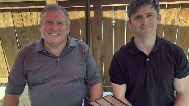 Buck Newsome, left, a Baby Boomer, and his son, Chris Newsome, of the Millennial generation, pose for a photo while having lunch together in Newtown, Ohio. American's two largest generations can agree on something: the coronavirus pandemic has hit them both hard.