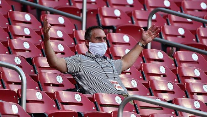 St. Louis Cardinals president of baseball operations John Mozeliak reacts during a workout July 10 at Busch Stadium in St. Louis.