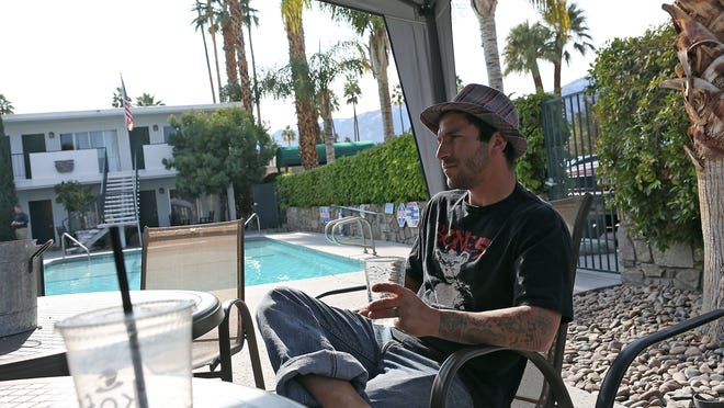 Benjamin Schneider, a recovering addict, is a tenant at the Palm Tee sober living home in Palm Springs. The former hotel is the largest sober home in the Coachella Valley. At top: The inside of a bedroom at The Alexander House in Palm Springs. The former boutique hotel is now a sober living facility.