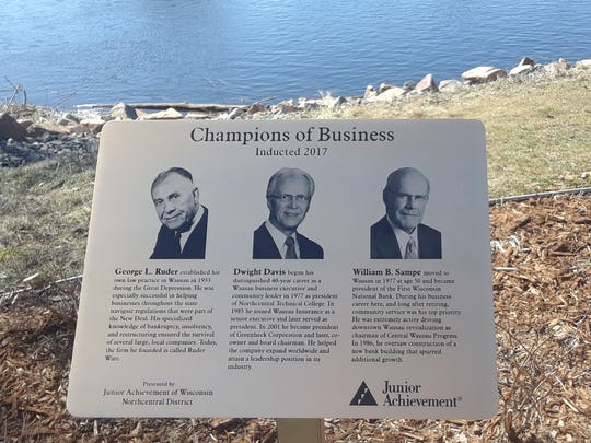 Bronze plaques in Wausau's new Champions of Business Inspiration Plaza share details about the area's founders and developers.