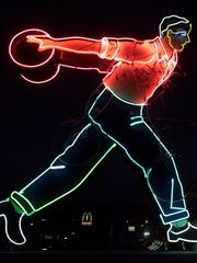 This 2000 photos shows the neon bowler that was on the roof of Plaza Lanes in Des Moines for decades. This bowler throws the ball for a strike and the ball lights up as it makes its way towards the pins.