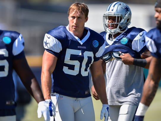 Sean Lee (50) prepares to run the defense during a