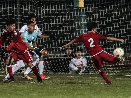 Desert Mirage's Erick Serrano, #2, makes a goal against