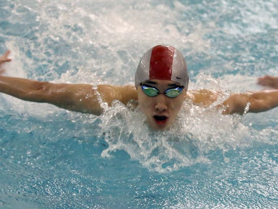 Jonathan Ma of Ardsley competes in the 100 meter butterfly