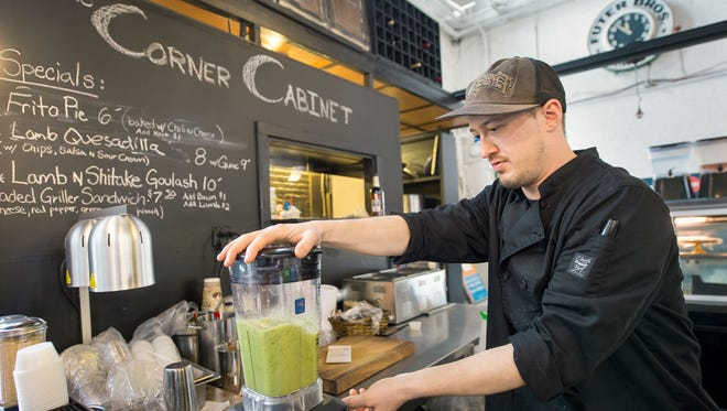 David Inder makes a smoothie at his new restaurant, The Corner Cabinet, at Central Market. Inder's restaurant is in the space formally occupied by Under One Sun.