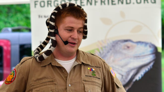 Jesse Rothaker will bring reptiles from Forgotten Friend to the Library Olympic Fest on Saturday.