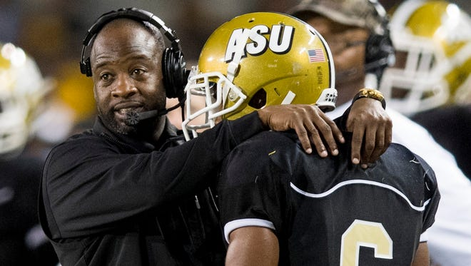Alabama State coach Brian Jenkins talks with Jeffrey Hill (6) against Alcorn at Hornet Stadium on the ASU campus in Montgomery, Ala. on Thursday October 5, 2017.