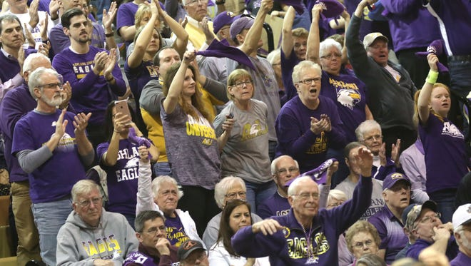 Fans of the Ashland University women's basketball team cheer on their team during the NCAA Division II championship in Columbus on Friday night.