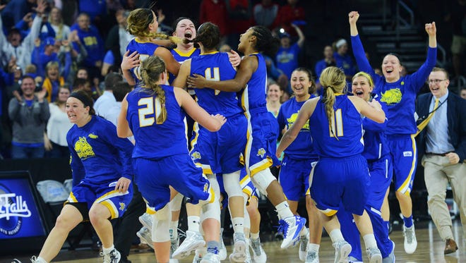 The SDSU Jackrabbits celebrate their 61-55 win over USD in the Summit League women's basketball championship Tuesday at the Denny Sanford Premier Center, March 8, 2016.