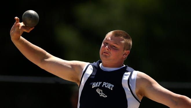 Bay Port's Cole Van Lanen makes a throw while competing in the Division 1 shot put during the WIAA state track and field meet at Veterans Memorial Field Sports Complex in La Crosse, Wis., on Friday, Van Lanen won the event for his second state title.