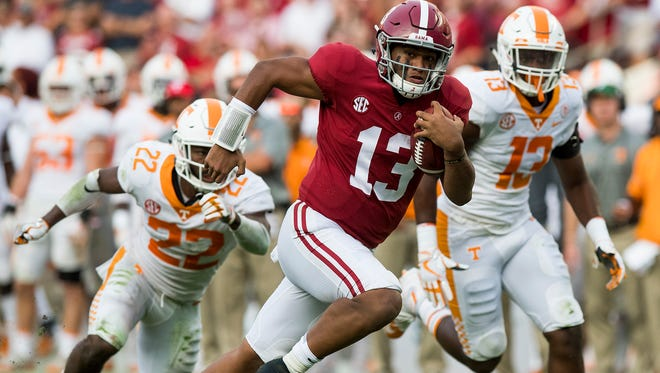 Alabama quarterback Tua Tagovailoa (13) carries for a touchdown in second half action at Bryant-Denny Stadium in Tuscaloosa, Ala. on Saturday October 21, 2017. (Mickey Welsh / Montgomery Advertiser)