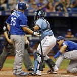 Tampa Bay Rays catcher Rene Rivera, second from right, tags out batter Kansas City Royals' Kendrys Morales (25) after tagging out Royals' Ben Zobrist, right, to complete a double play during the eighth inning Sunday in St. Petersburg, Fla. The Rays won 3-2.