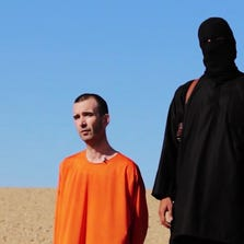 This image made from video posted on the Internet by Islamic State militants and provided by the SITE Intelligence Group, a U.S. terrorism watchdog, on Saturday, Sept. 13, 2014, purports to show British aid worker David Haines before he was beheaded.