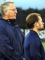Pocomoke coaches Alan Byrd and Chris Roberts watch their players accept runner-up medals after the MPSSAA 1A state soccer final on Saturday, Nov. 19, 2016 at Loyola University in Baltimore.