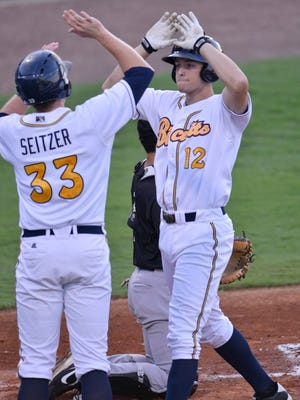 Montgomery Biscuits' Cameron Seitzer (33), left, congratulates Richie Shaffer (12) after Shaffer hit a home run during their game with Jackson Generals at Riverwalk Stadium on Wednesday July 16, 2014.