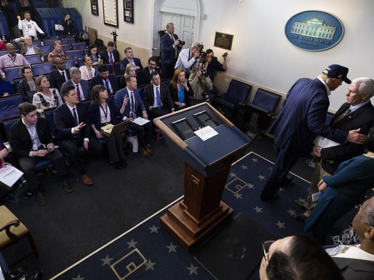 President Donald Trump grabs the arm of Vice President Mike Pence as he departs after speaking during a news conference about the coronavirus in the James Brady Briefing Room at the White House, Saturday, March 14, 2020, in Washington. (AP Photo/Alex Brandon)